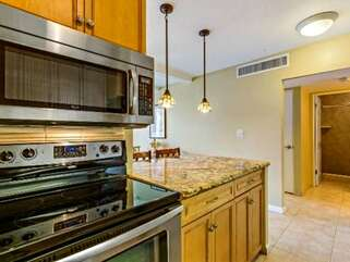 Full Kitchen with Stainless Steel Appliances and Granite Counter tops