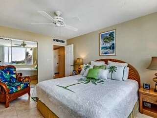 Main Bedroom with Tropical Decor and Ceiling Fan