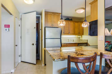Kitchen with Bar Seating and Granite Counter Tops