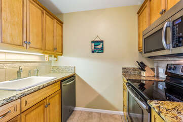 Full Kitchen with Wooden Cabinets and Stainless Steel Appliances