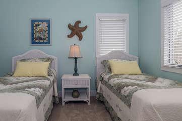 The first floor bedroom #2 features twin beds, dresser and an en suite bath.