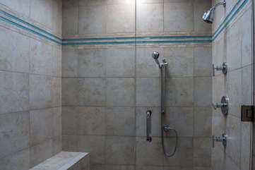 A large tiled shower with skylight highlight the master bath.
