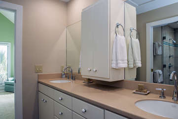 The master bathroom has double sinks and a walk in closet.