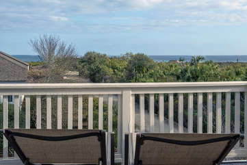 A beautiful view of the protected dunes and the ocean from the deck off the main living area.