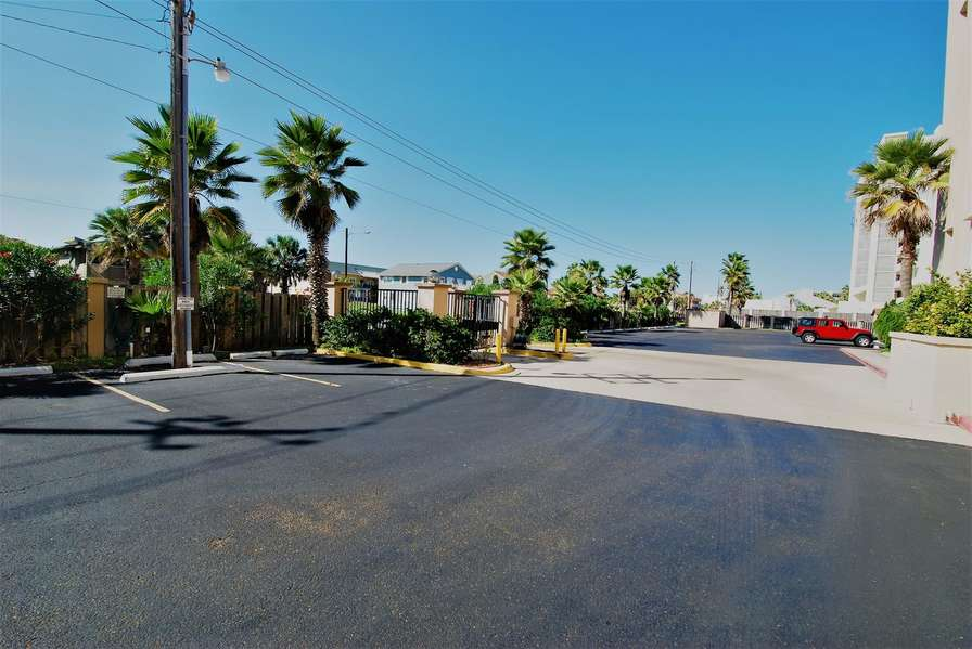 Gated & Fenced parking lot - parking is located very close to building and elevator