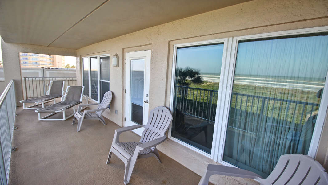 Enjoy the Sunrise over the waves. Door leads into the living room.