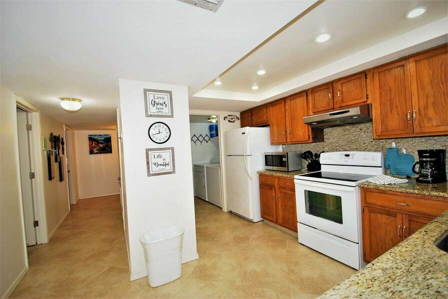 Fully equipped kitchen/ In unit laundry room (washer & dryer)