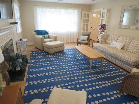 Family room with couch and oversized chair , plenty of seating for the whole family. 80 Landing Lane Chatham Cape Cod - New England Vacation Rentals