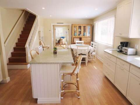Kitchen with Coffee maker and toaster oven, opens to dining area with seating for 6. Stairs to second level.80 Landing Lane Chatham Cape Cod - New England Vacation Rentals