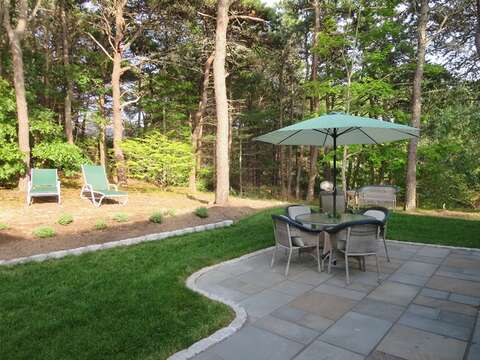 Back Patio with dining table , 2 lounge chairs and gas grill - 80 Landing Lane Chatham Cape Cod - New England Vacation Rentals