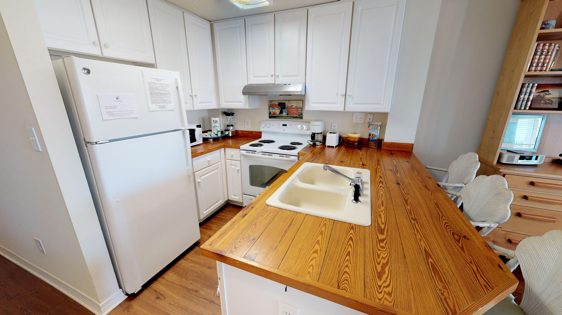 Apartment kitchen is fully equipped to prepare meals