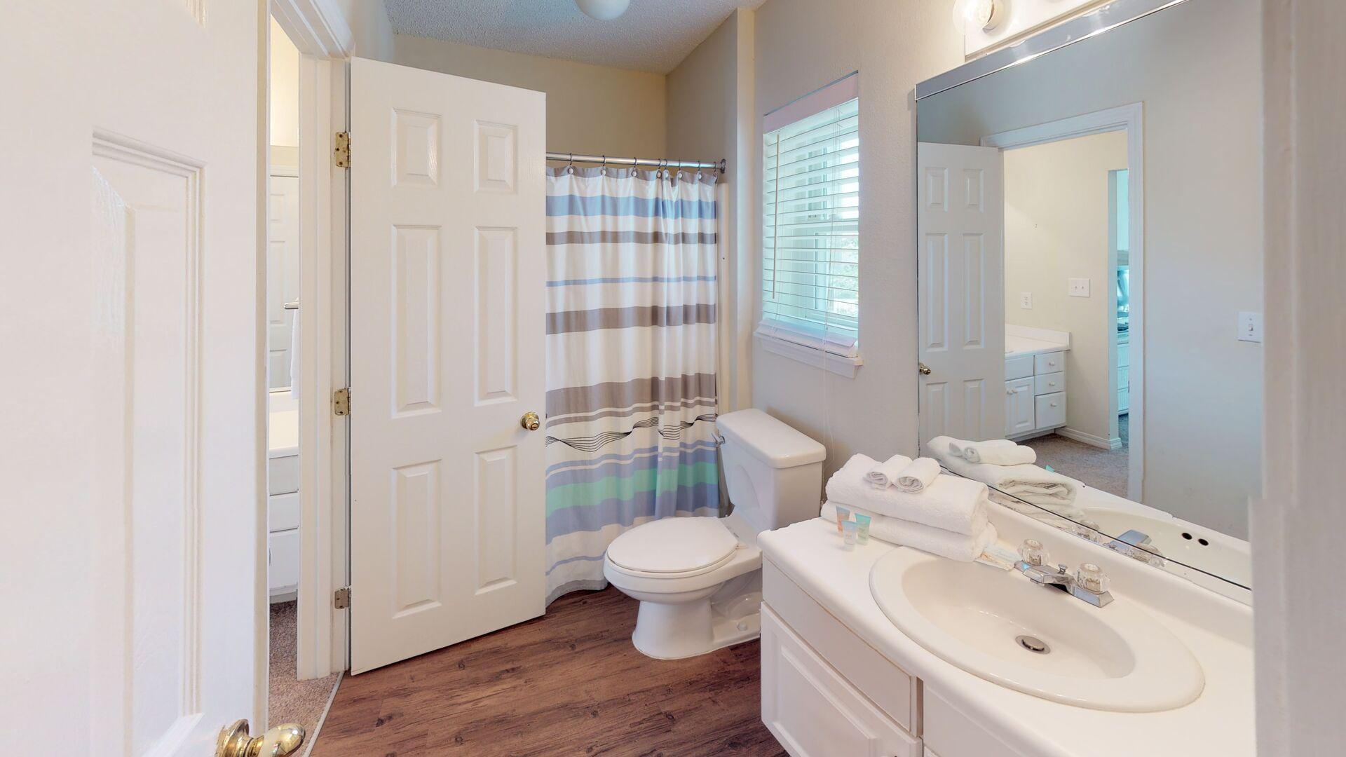 Master bathroom has a tub/shower combo