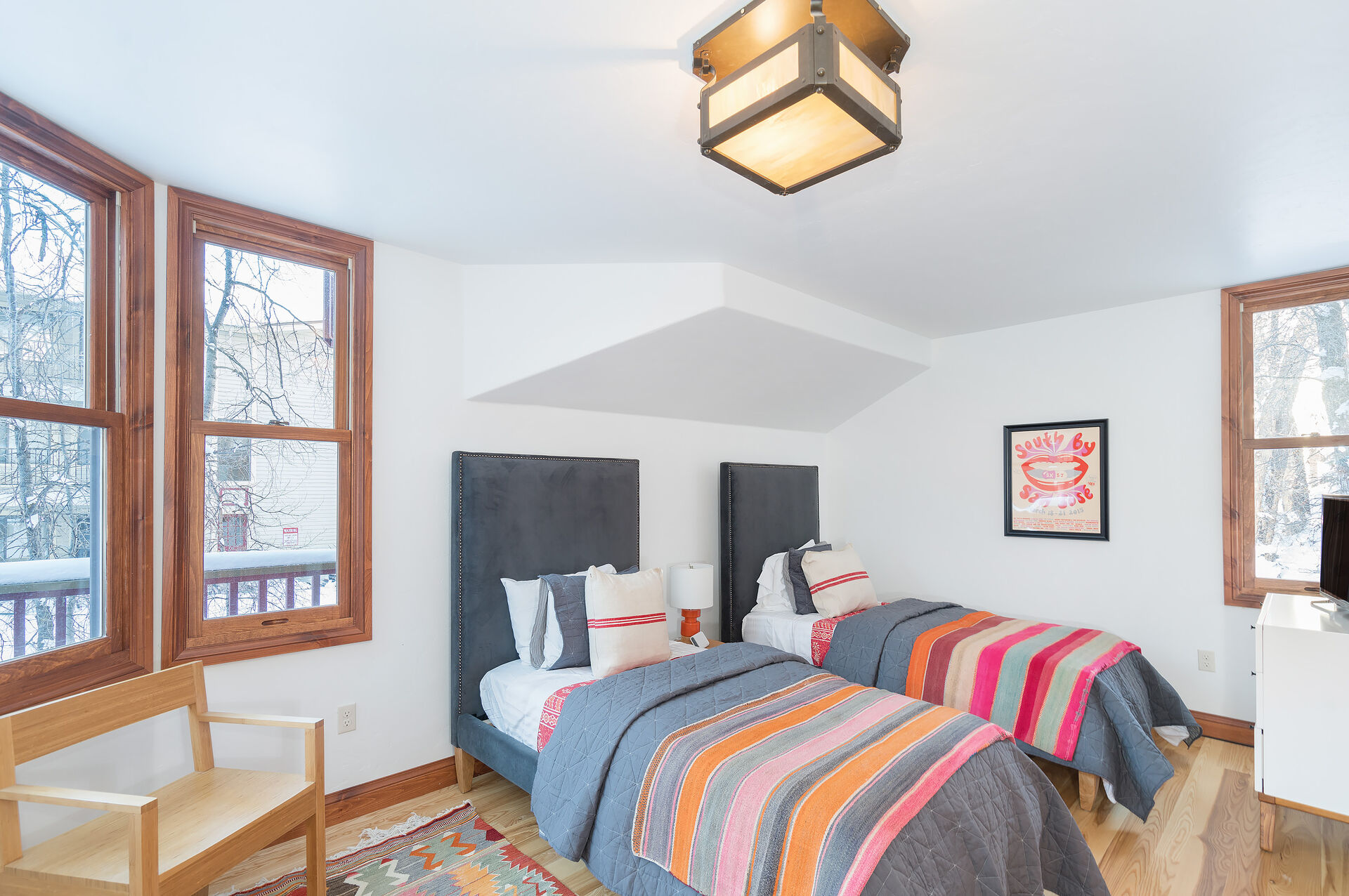 Bedroom with Two Beds, Drawer Dresser, Smart TV, and Chair