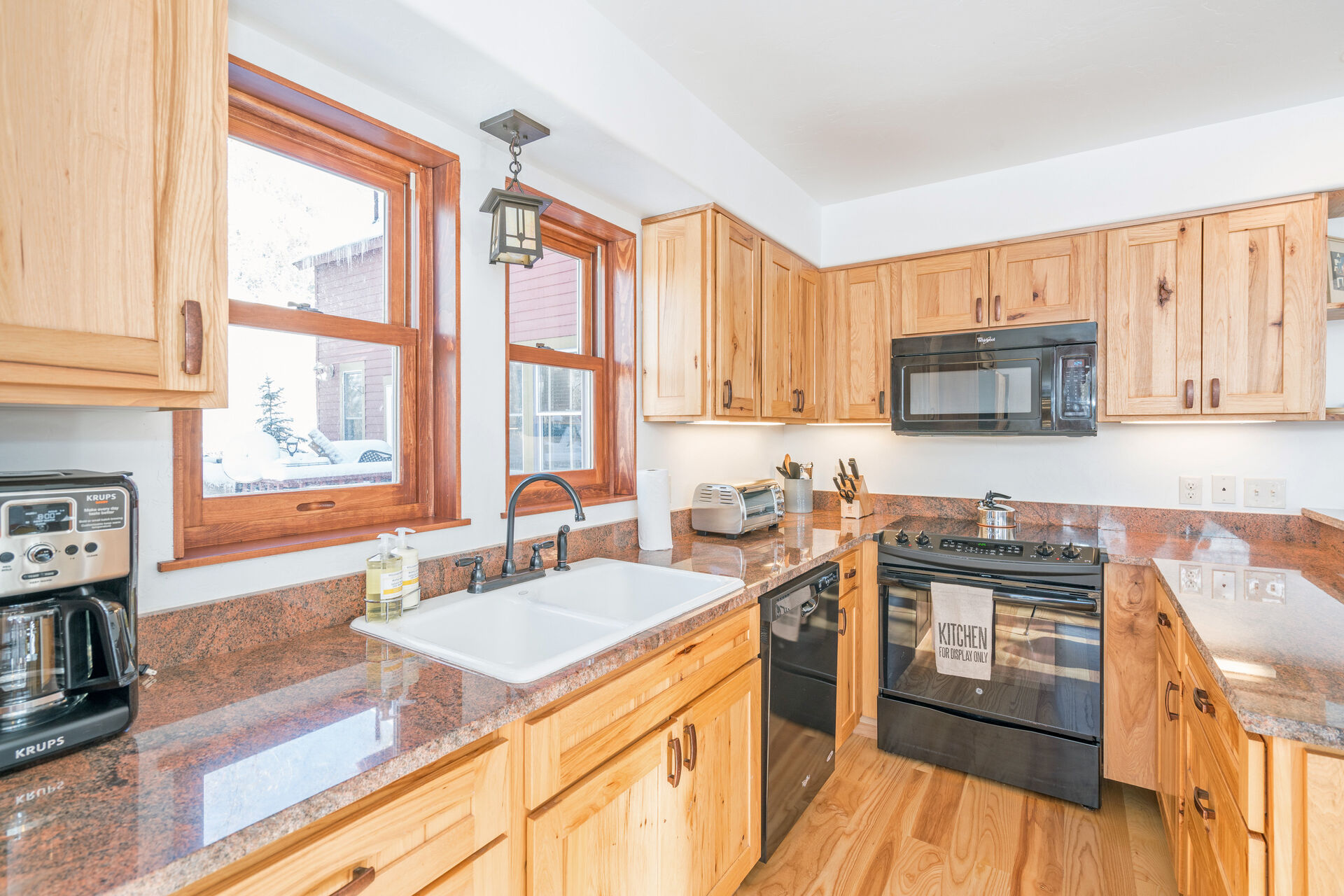 Kitchen with Microwave, Dishwasher, and Coffee Maker