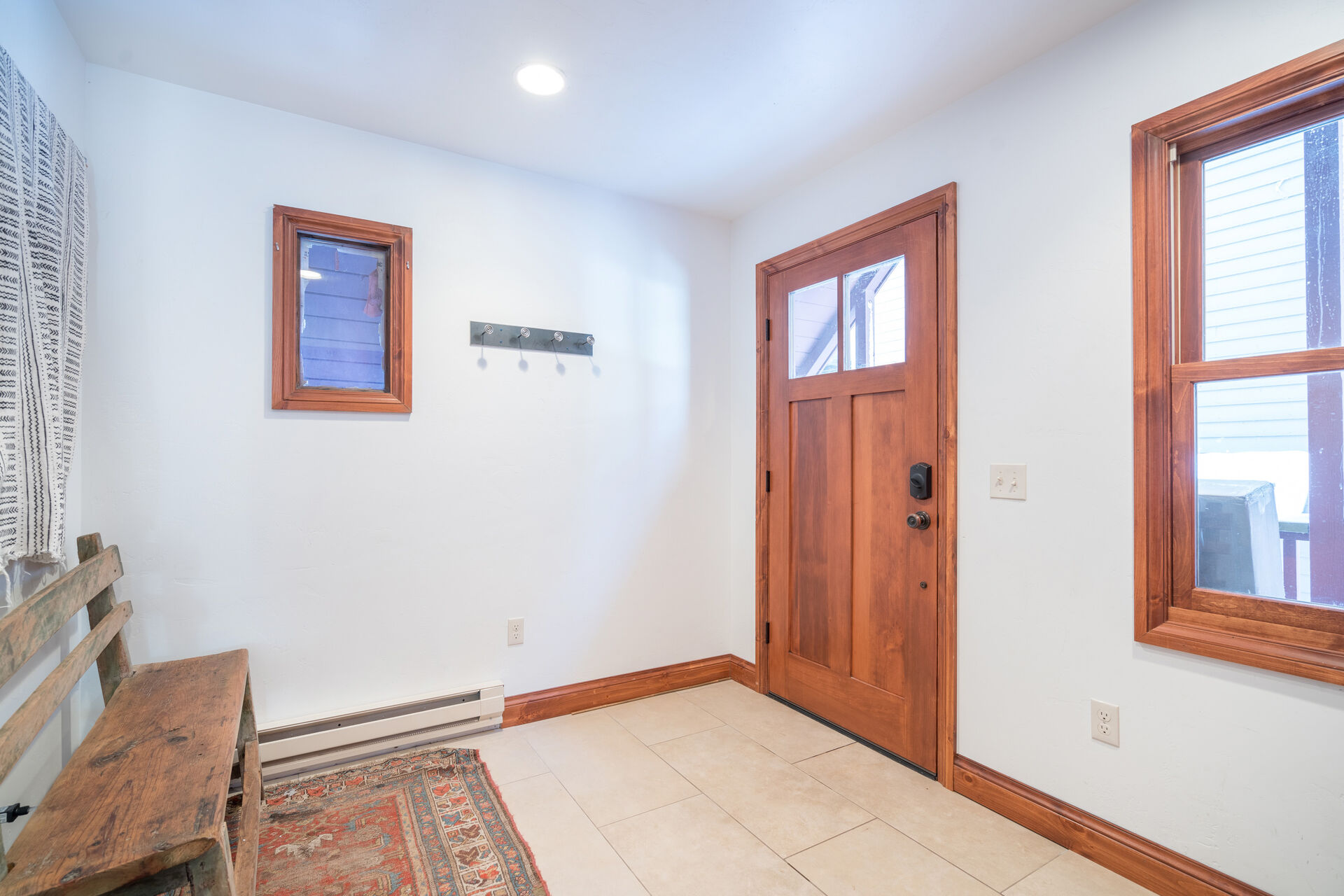 Spacious Foyer with a Bench
