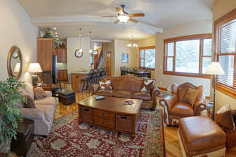 Massive space in an open concept layout combines the living room, dining room, and kitchen