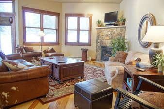 The main Living Room has a flat screen HDTV, gas fireplace, and seating for 8