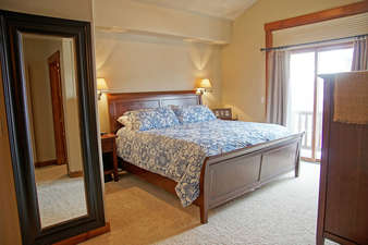 The Master Bedroom has a King bed, reading lights on dimmers, and a private balcony