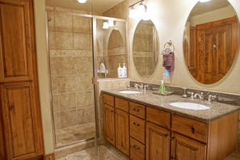 Master Bathroom has dual under-mounted sinks and a walk in shower