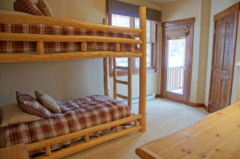 Bedroom 3 has 2 Twin beds and a private balcony