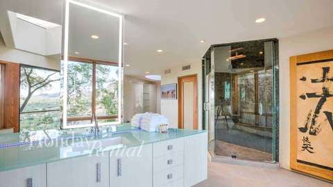 His and Hers Master Vanities, walk in shower to the right