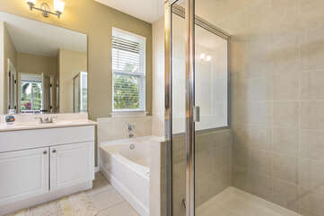 Master bathroom offers separate shower/tub