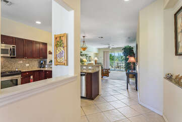 Entryway and Kitchen Area with Views of the Living Room and Outside