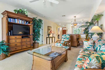Living Room with Tropical Decor and TV