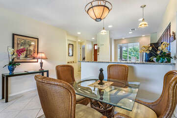 Dining Area with Glass Table and Comfortable Chairs at Waikoloa Hawaii Vacation Rentals