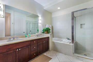 Bathroom with His/Hers Vanity, Walk-in Shower, and Bathtub