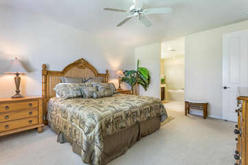 Large Bed with Wooden Headboard and Ceiling Fan at Fairway Villas Waikoloa C22
