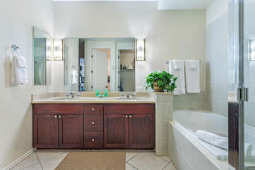 Bathroom with Bathtub, Walk-in Shower, and Vanity with Wooden Cabinets