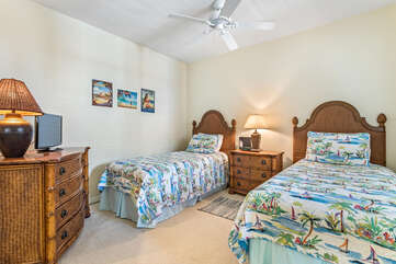 Bedroom with 2 Twin Beds, Tropical Decor, and TV at Waikoloa Hawaii Vacation Rentals