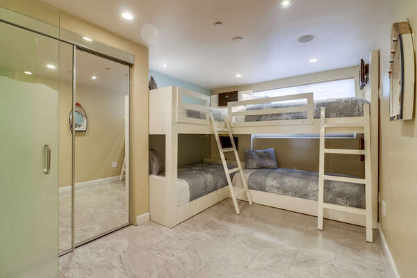 Tiled Bedroom with four Twin/Twin Bunk Beds