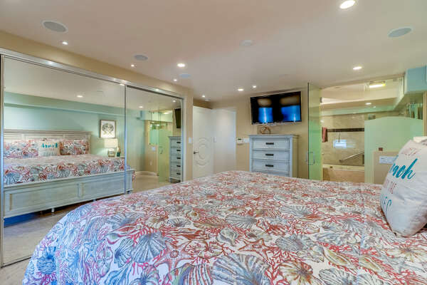 Master Bedroom with King Bed, TV, Mirrored Closet, and Ensuite Bathroom