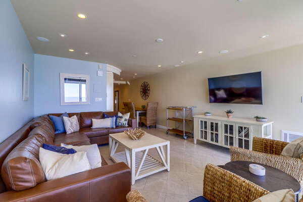 Living Area with Leather Sectional and TV