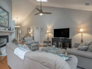 There is a large screen HDTV/DVD in the great room. The great room has a ceiling fan and the remote for the fan is in a basket on the side table to the left.