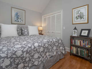 Off the foyer area is the second bedroom with a queen size bed.