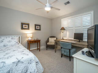 The third bedroom has a twin bed and office set-up.