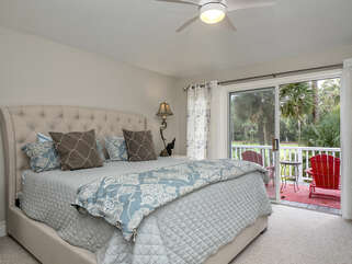A sliding door in the master bedroom leads to the open deck with a view of the pond and the 4th hole of Crooked Oaks.