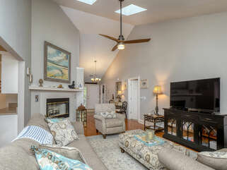 There is plenty of conversational seating in the great room. There are skylights with shades in the great room and the tool to open the shades is stored in the master bedroom closet.