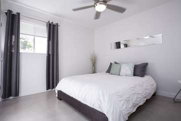 Bedroom 2: Queen bed with Comfy Mattress and high-quality linens.