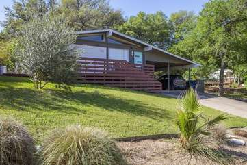 Exterior with large yard, wrap around deck and carport.