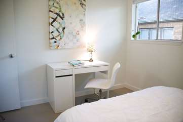 Comfy second bedroom includes a desk if you need to work.