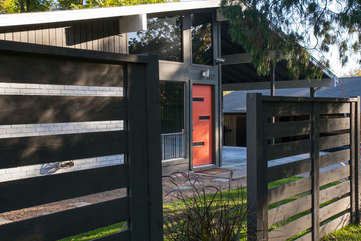 The peach door, located on a quiet street in coveted Travis Heights.