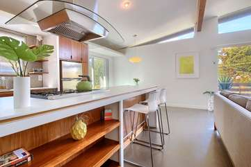 The kitchen island - perfect for meals, games, or laptop time. There's also a dining table for four plus a patio table for four.