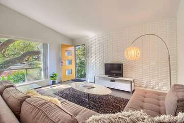 Living room features a comfy sectional sofa and ROKU TV.