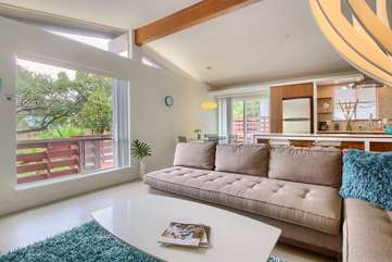 The Blue Door has an Open Floor Plan, Vaulted Ceilings, and Large Windows.