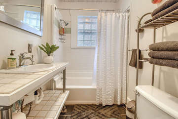 Bathroom features a tub/shower combo.