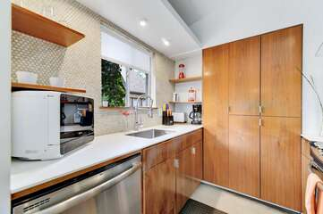 The kitchen is stocked with dishes and appliances to make meals at home